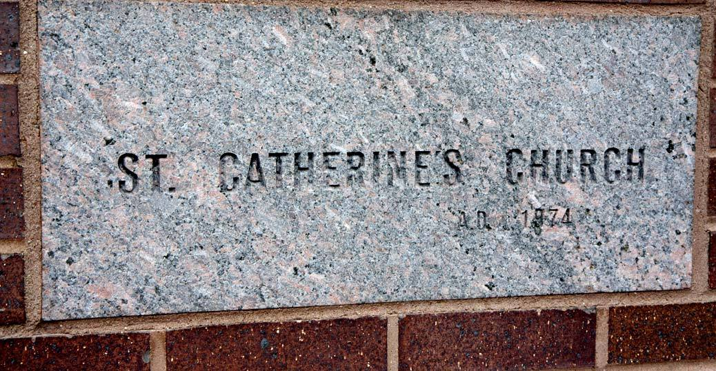 The cornerstone of the current church, located to the right of the entrance.